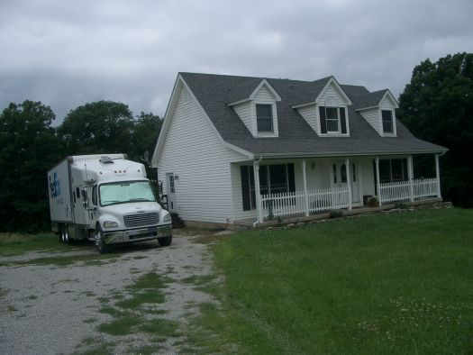 Front_of_house_with_truck_summer.JPG