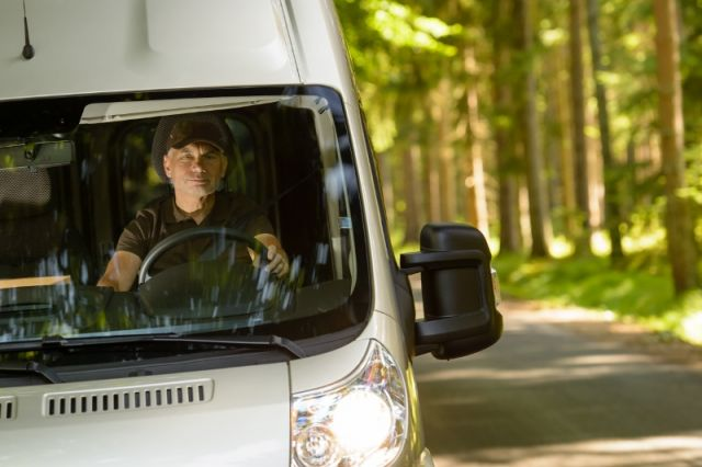 Expediter Driving Through the Woods to Make Delivery